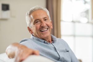 Smiling senior man with dental implants in Trumbull